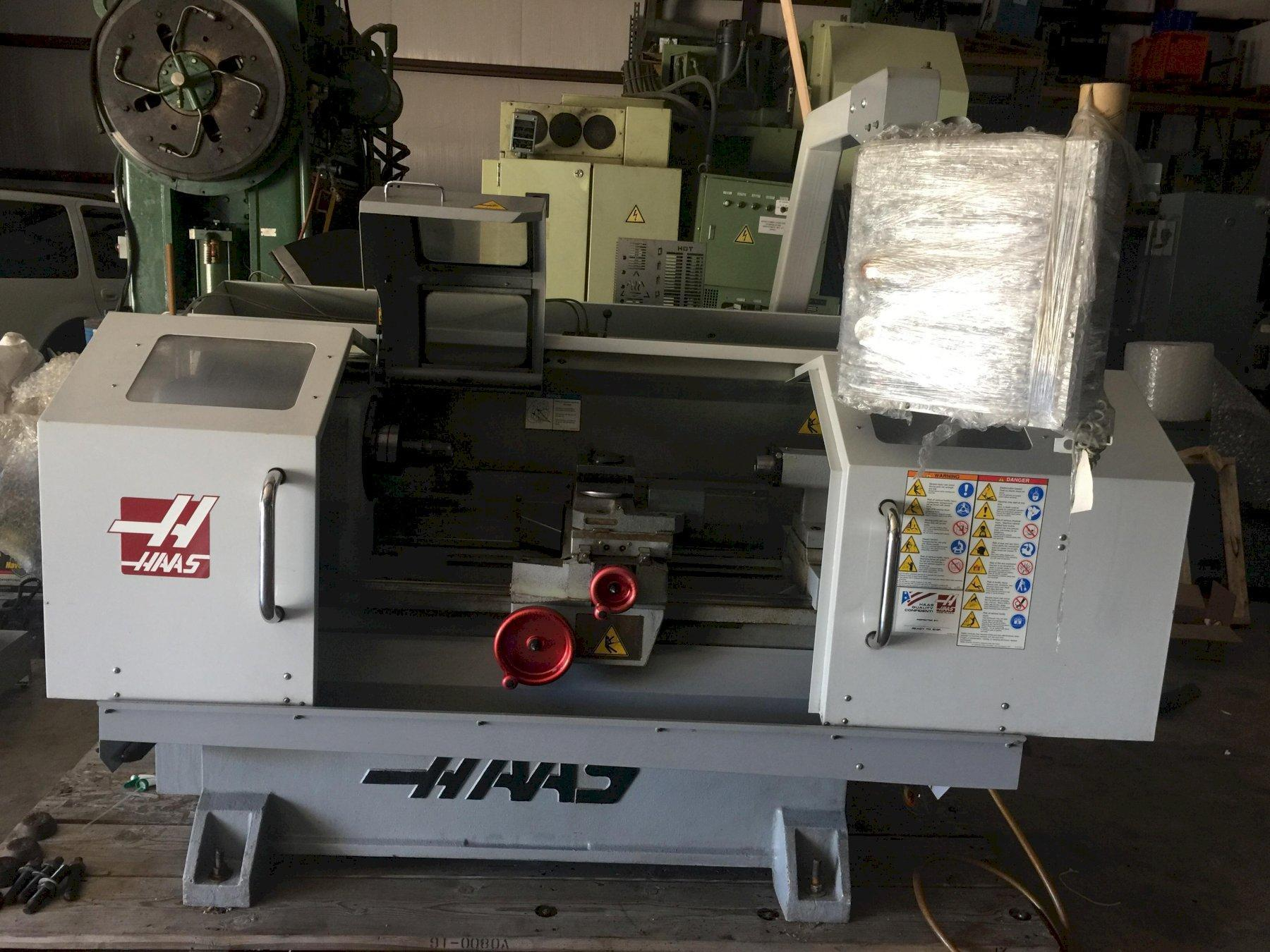 Haas TL-1 Toolroom Lathe 2008 with: Haas Control, Manual Tailstock, A2-5C Collet Chuck, Rigid Tapping, and Coolant Tank.