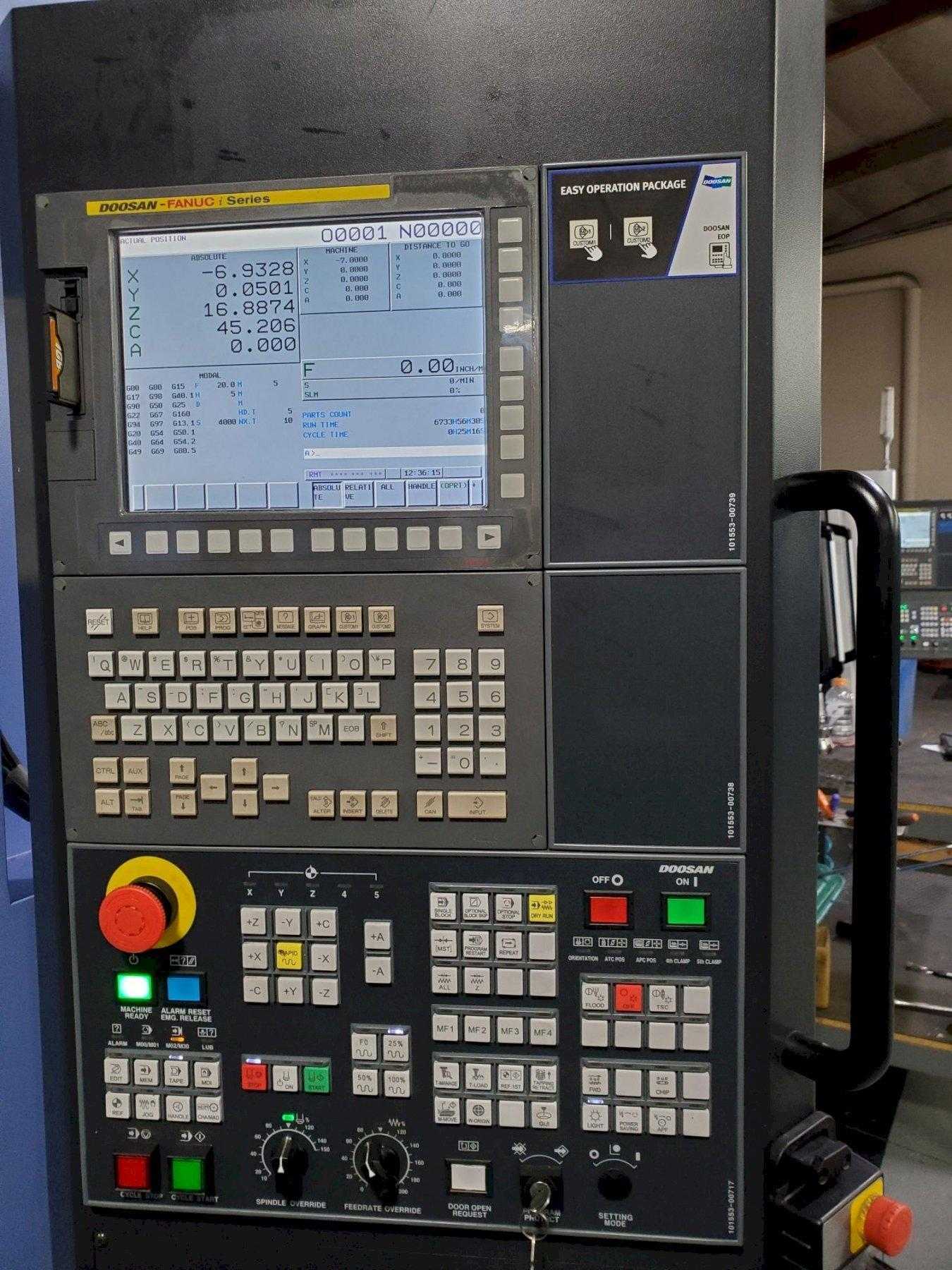 Doosan DNM 200-5AX: 5-Axis VMC 2017 with: Fanuc Oi-MD CNC Control, Renishaw Probing System, 200 Block Look Ahead, Rigid Tapping, Spindle Chiller, and LNS Chip Conveyor.