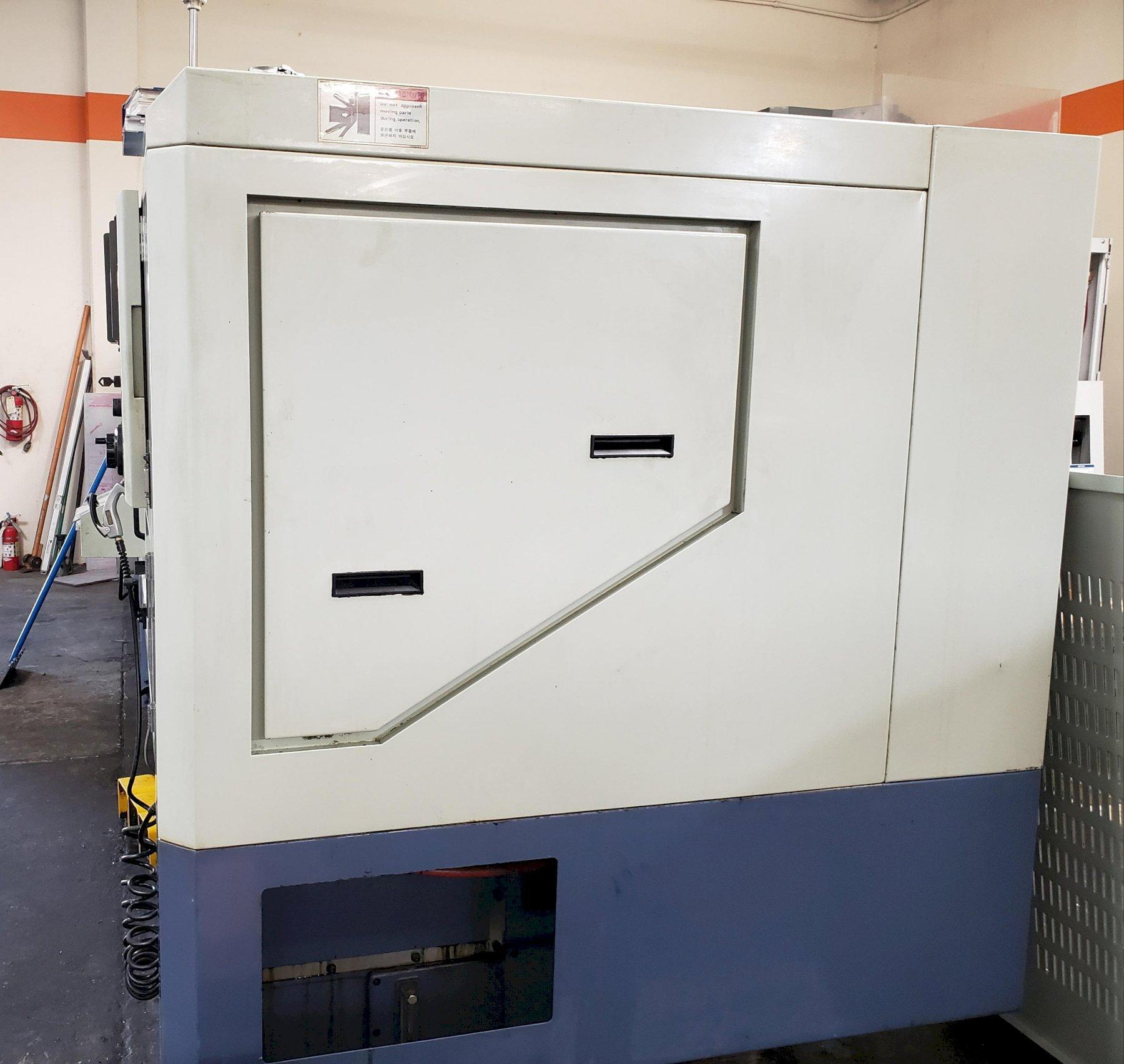 "Hwacheon Hi-Tech 200AI CNC Lathe 2003 with: Fanuc Oi-T CNC Control, 8"" Chuck, Tool Presetter, Tailstock, Air Gun, Coolant Tank, and Chip Conveyor."