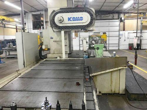 """KOMO VMC-160/50, Fanuc 16 CNC Control, 162"""" x 36"""" Table, X=162"""", Y=36"""", Z=32"""", 20"""" 4th Axis Rotary Table, 50 Taper, 30 Station Tool Changer, New 11/1996."""