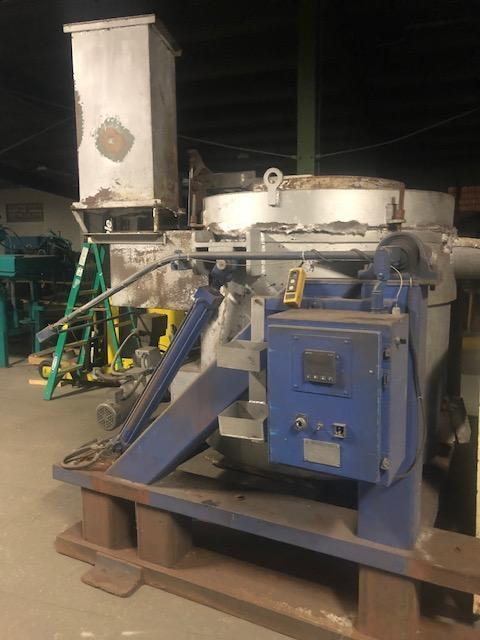 Thermtronix model gt600 gas fired tilting crucible furnace s/n 1622 rated at 800# capacity, 450# per hour melt rate, hydraulic operated tilting and cover, Eclipse veri-flame burner control, West digit