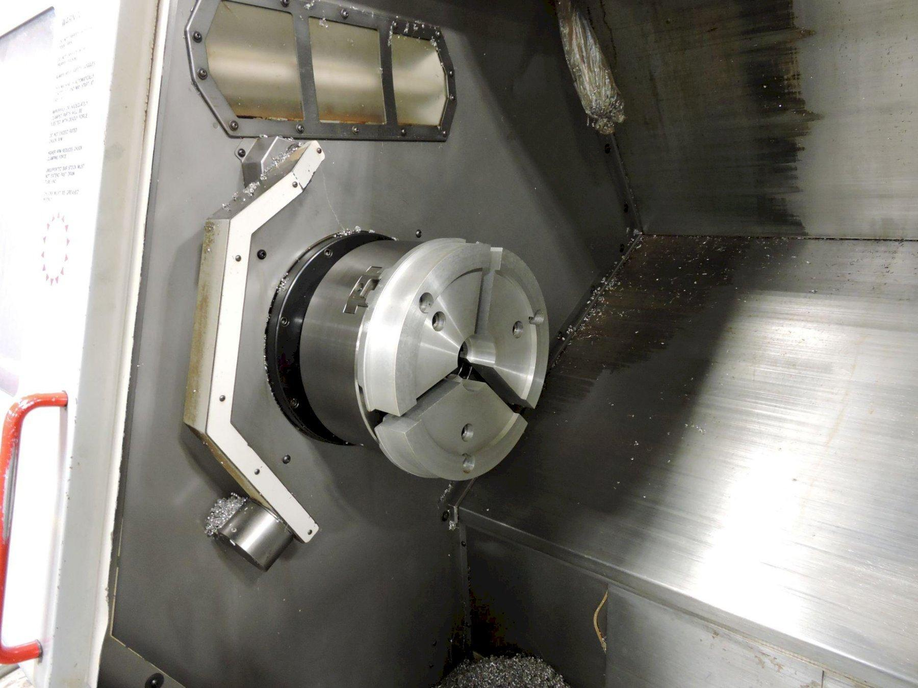 """HAAS SL-40T CNC TURNING CENTER, Haas CNC Control, 40"""" Swing, 15"""" 3-Jaw Chuck, 51"""" Between Centers, 4"""" Bar Capacity,  2400 RPM Spindle, 10-Position Turret, Tailstock, Chip Auger, New 1999."""