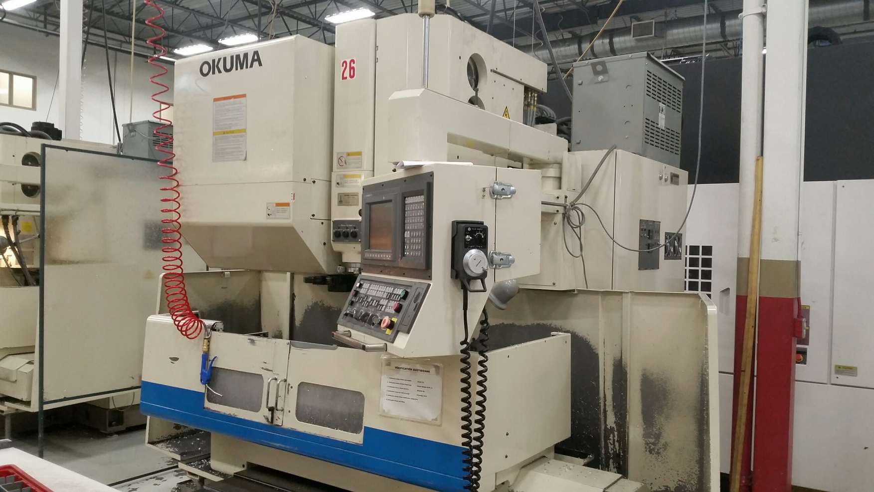 OKUMA MC-40VB CNC VERTICAL MACHINING CENTER WITH 50 TAPER SPINDLE AND 4TH AXIS DRIVE