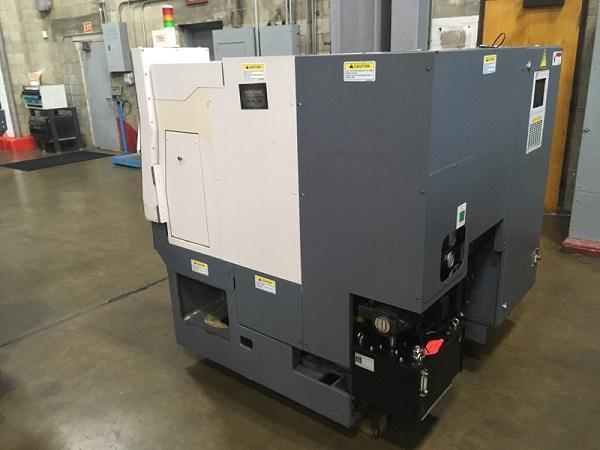 """OKUMA GENOS L250, OSP P200L CNC Control, Collet Chuck, Max Swing Over Saddle 12"""", Tailstock with 13"""" Centers, 10HP, 4500 RPM, Chip Conveyor, New 2012."""