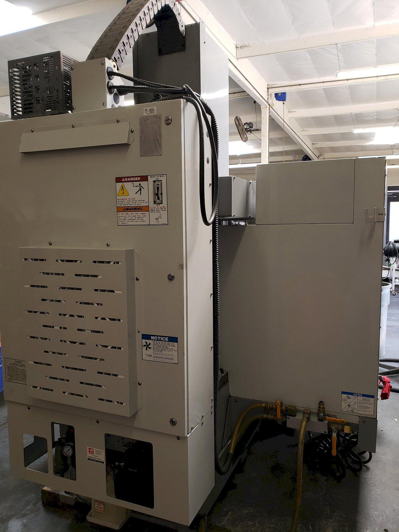 Haas VF-1B Vertical Machining Center 2007 With: Programmable Coolant, 2-Speed Gear Drive, Chip Auger, and Coolant Tank.