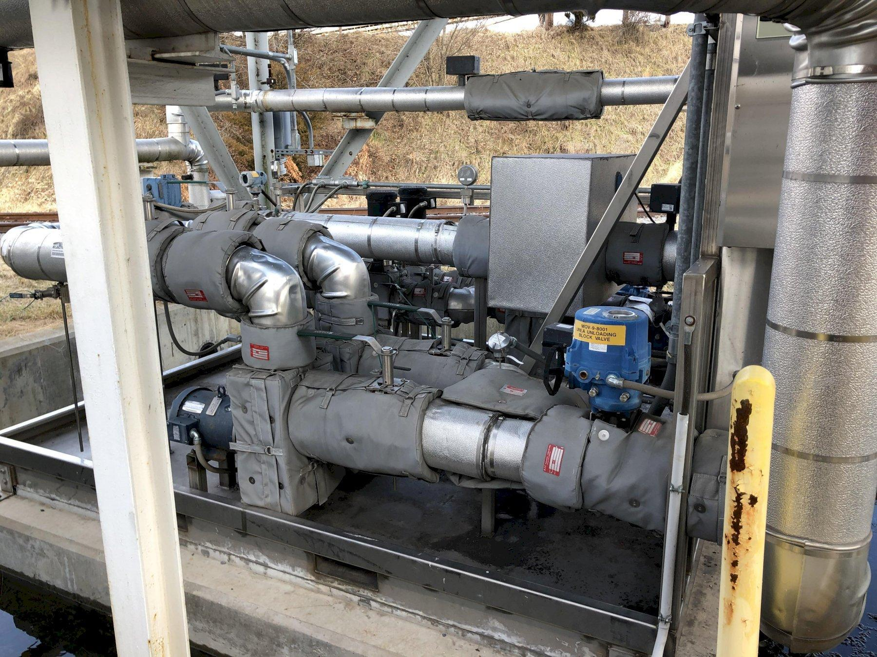 Urea system with 2- #1 and #2 pump buildings each with 2- 10hp pumps and motors with stainless steel enclosures, heated piping, 2- urea holding tanks, sdm controls, fuel tech sdm drive system with 2- 7.5 hp urea pumps, 2- 7.5 hp dilution pumps and rr unloading station