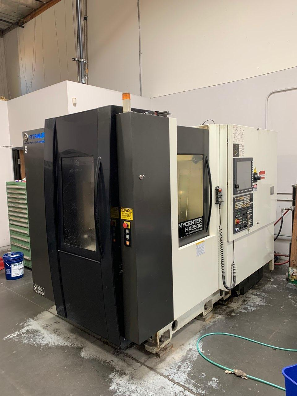 Kitamura Mycenter HX250G HMC 2014 with: Arumatik-Mi CNC Control, Laser Tool Setter, Spindle Probe, 15k RPM Spindle, BT-30 Taper, 40-ATC, TSC, and Chip Conveyor.