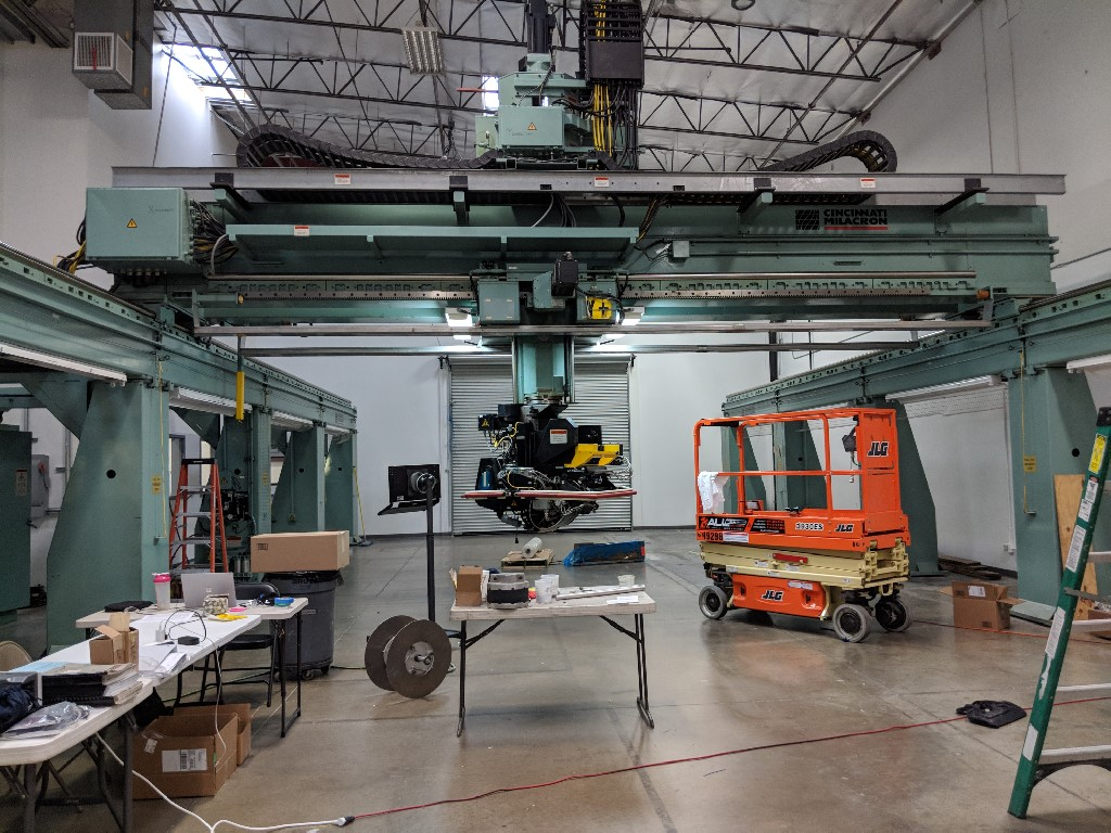 """Cincinnati FTLM 7-Axis Tape Laying Machine; 648"""" x 200"""" Work Surface, 27-63"""" Work Height. 36"""" Z axis. Use in aircraft skins. Over $3MM new"""
