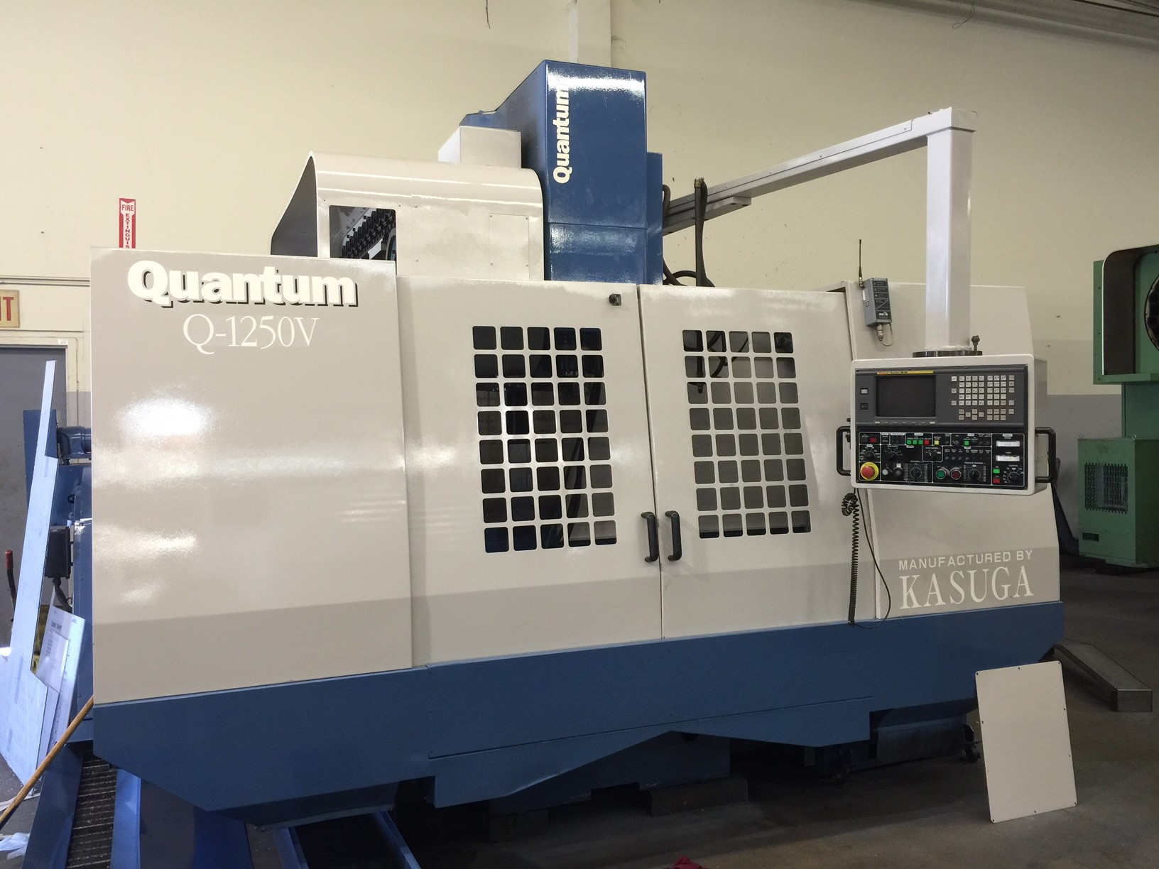 "Kasuga Quantum Q-1250V, 50""x25""x25.6"", 6K RPM, 25HP, CT50, 40ATC, Fanuc 18M Ctrl, Chip Conveyor, Tsudakoma 4th Axis, Tailstock, Rigid Tapping"