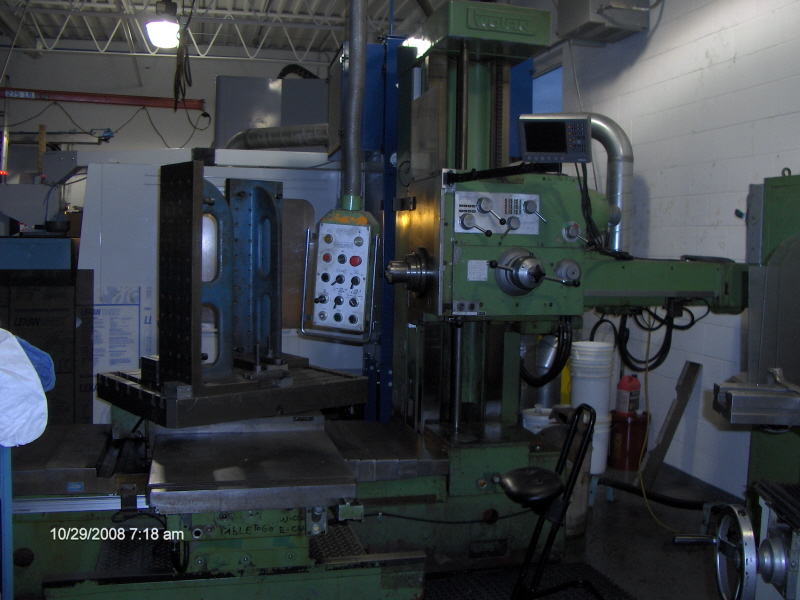 "4"", 57x40x32, 50 TAPER, 39.5 TABLE, 06 4AXIS READOUT, LOTS OF TOOLING"