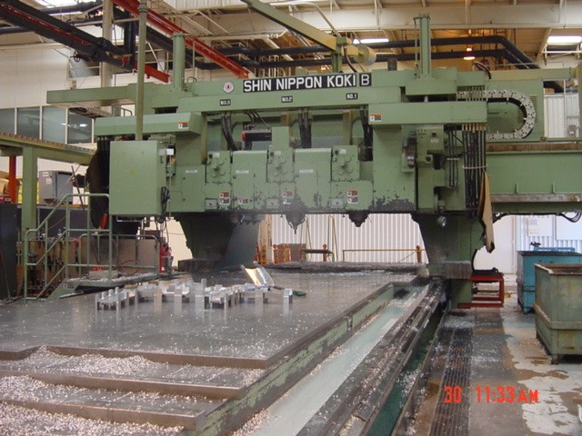 SNKTwin Gantry 3-Spindle 5-Axis Profile, (2) Fanuc 15M CNC Controls, CAT-50, Coolant