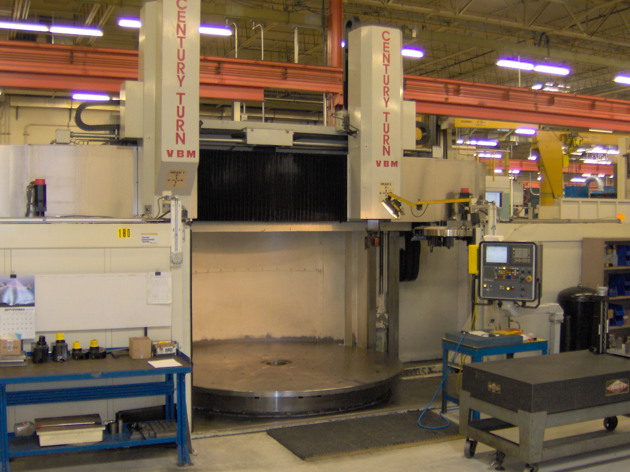 "NEW CENTURY110"" TABLE, 126"" MAX. SWING, 2 RAMS, CHIP CONVEYORS, FANUC 18I-TA 4-AXIS CONTROL"