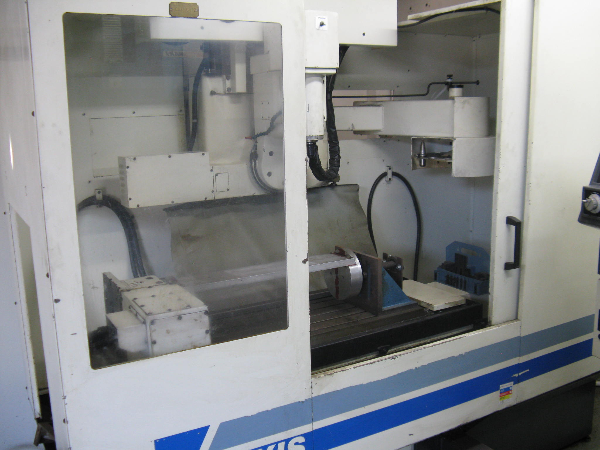 "Bostomatic 405 5-Axis Machining Center Vertical; New 1996. 20""x9""x16"", +/-190 Deg, 48""x14"" Table, CAT30, 13K RPM, 18 Station ATC, Tooling, Coolant, Probe"