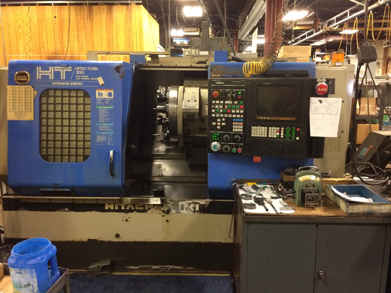 Hitachi Seiki 30G, New: 1995, chip conveyor and collet system