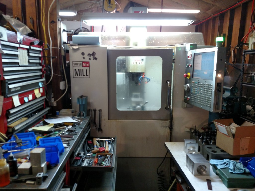 """HAASHaas Super Mini Mill, 16"""" x 12"""" x 10"""", 40 Taper, 10K RPM, High Coolant Pump, Rigid Tapping, Covers, Holders and Vises. Low hours!"""