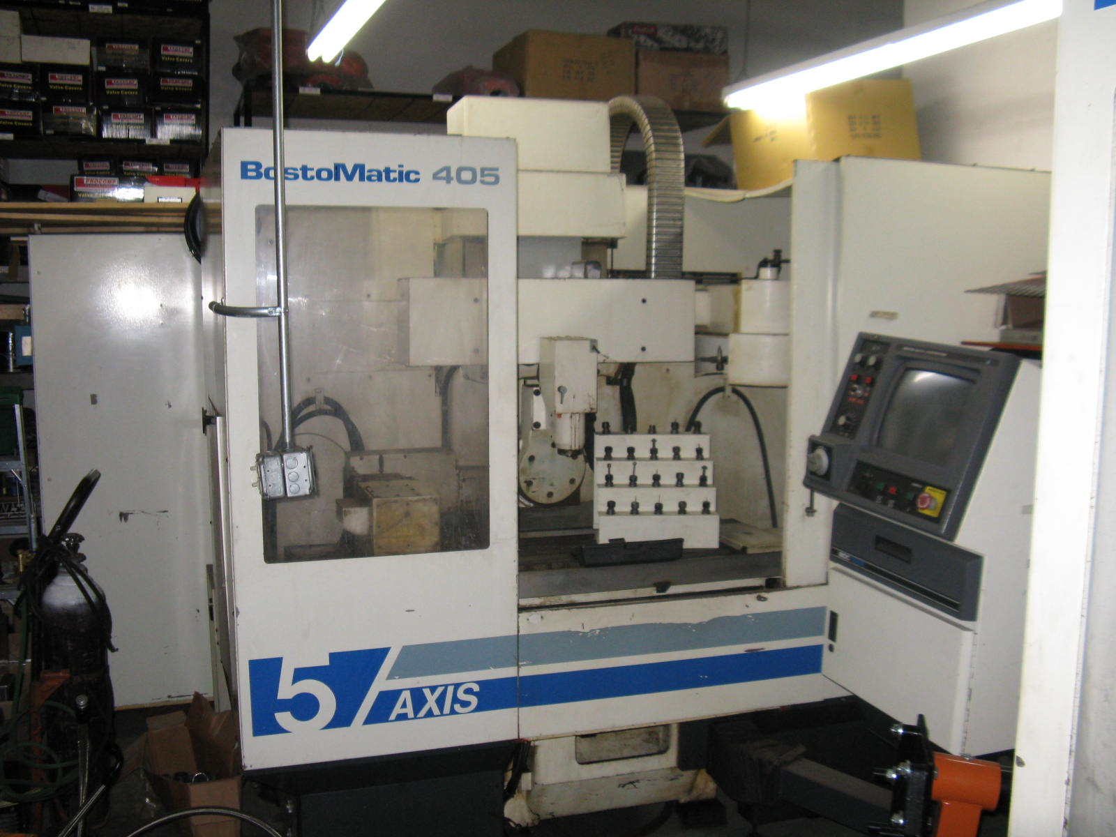 "Bostomatic 405 5-Axis Machining Center Vertical; New 1996. 20""x9""x16"", +/-190 Deg, 48""x14"" Table, EJ-16 Taper, 50K RPM, 18 Station ATC, Tooling, Coolant, Probe"