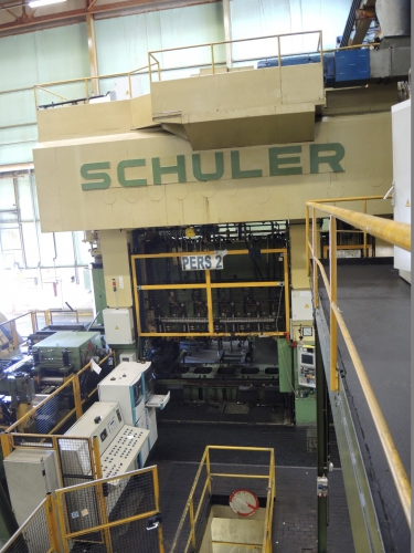 SCHULER PST-2000/7/600, 7 STATION DIE PRESS, MODERNIZED IN 2000 WITH NEW PLC SIEMENS S7
