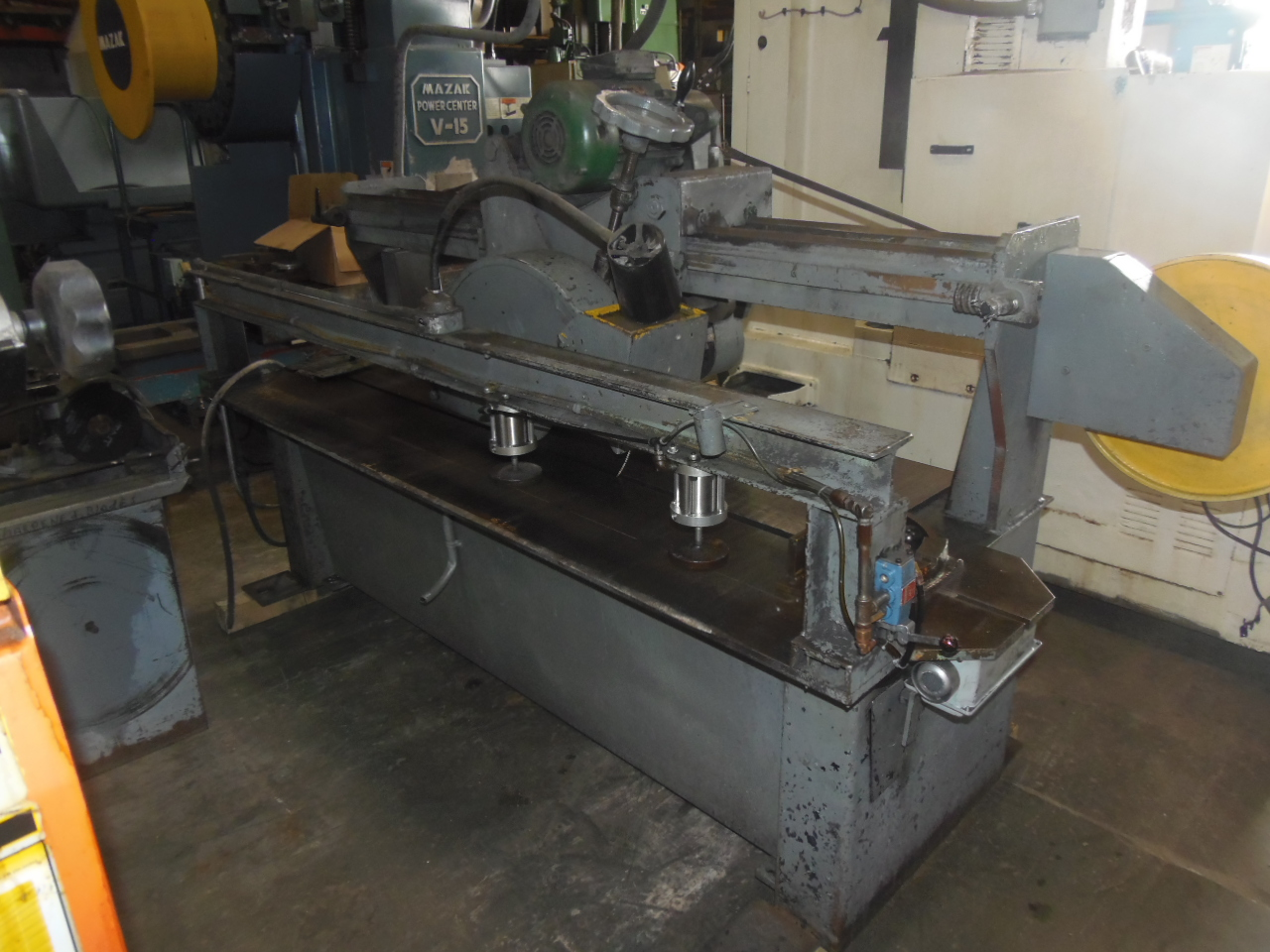 "PROMACUT LONG BED TRAVERSING CUT-OFF SAW, MODEL UNI-9-15, 15 HP, 21"" DIA. BLADE, 3000 RPM, 3' x 6' TABLE, 6' TRAVEL, BLADE SHARPENER"