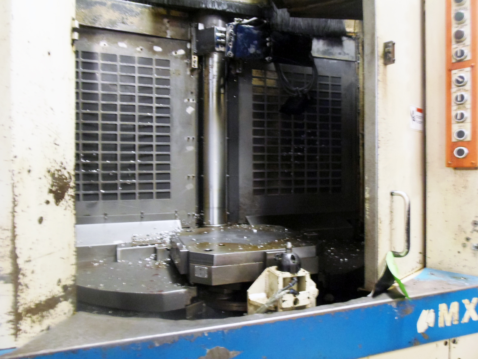 OKUMA MX50HB, DUAL PALLETS, OSP7000M CONTROL, ONE DEGREE, 5,000 RPM, THRU SPINDLE COOLANT, 1998