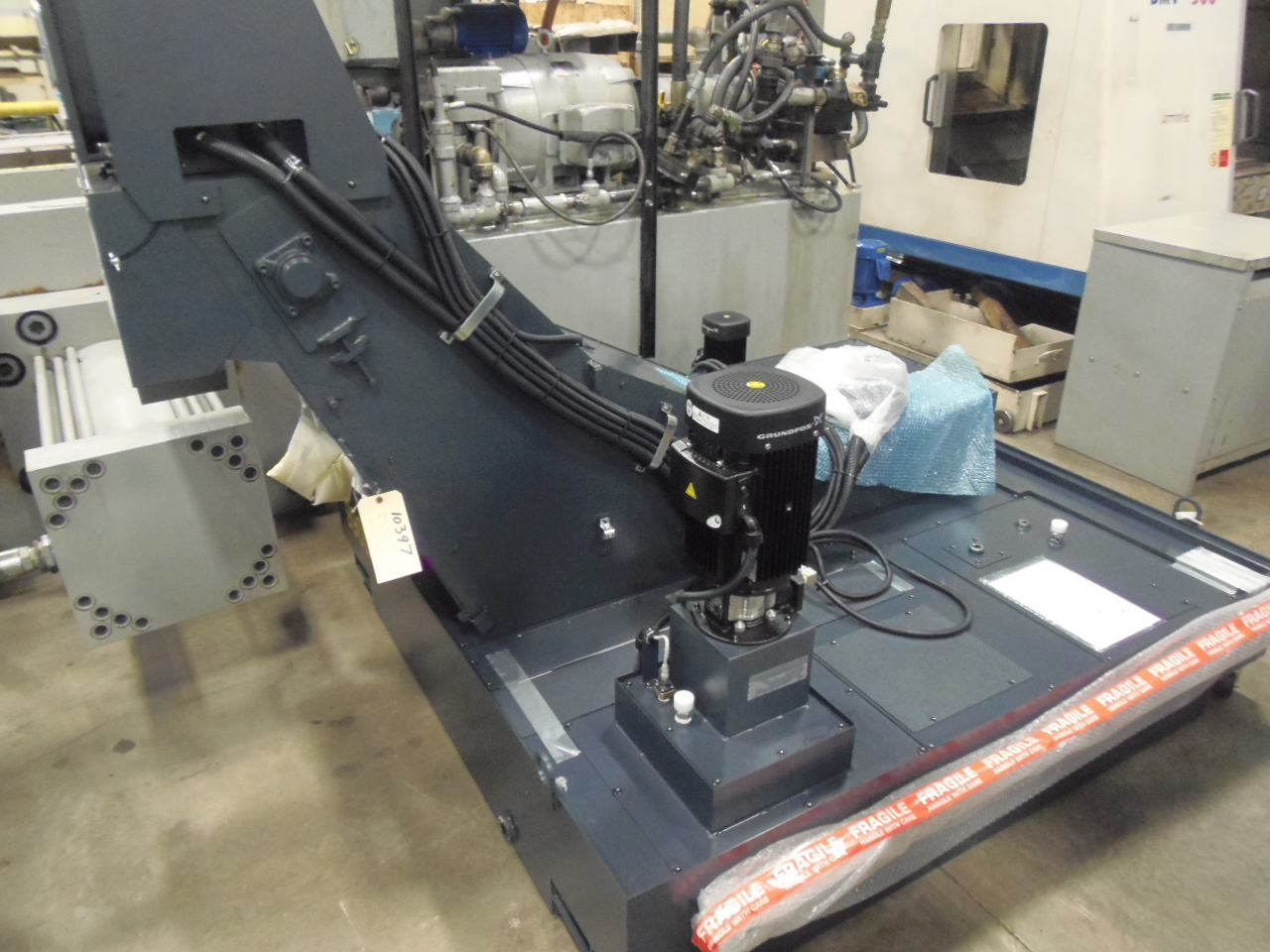 UNUSED HI PRESSURE COOLANT/CONVEYOR SYSTEM FROM MAKINO A61 HORIZONTAL MACHINING CENTER