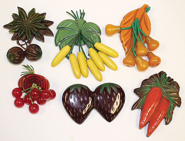 Showing some of the vintage Bakelite fruit form pins & pendants