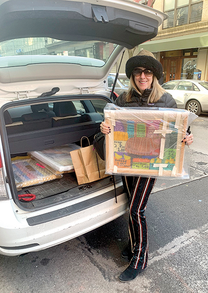 Paula Burns of Barrington, Rhode Island, has made a pilgrimage to the Outsider Art Fair for the last several years, spending the weekend viewing and buying what she loves. She was packing the car with her purchases when M.A.D. returned to the fair on Sunday.