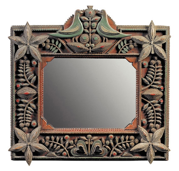 "pollack0320  ""A Token of Love"" An Extraordinary Painted and Carved Mirror  American; pine, last quarter of the 19th century. Adorned with symbols of love—hearts, flowers and lovebirds—this unusual piece was most likely made as a marriage gift. It is intricately carved and  beautifully painted in reds, greens, blues and silver. A sophisticated example of folk at its finest. Height 16½"