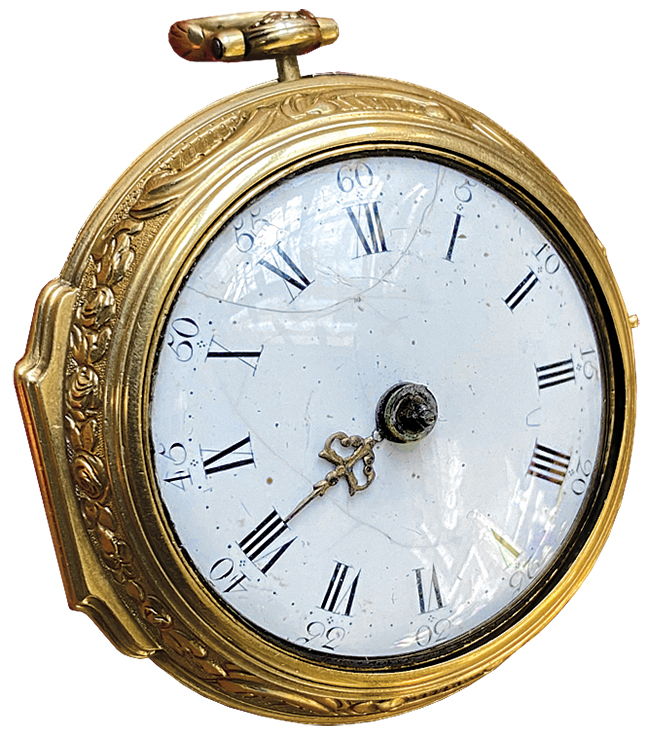 An 18th century Repousse watch with a gold outer cover