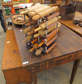 Bob And Peggy Mowrey Offered This Wine Rack Full Of Wooden Rolling Pins  Priced From $25 To $50. The Farm Table Was Priced At $695, And The Bench  Was $295.