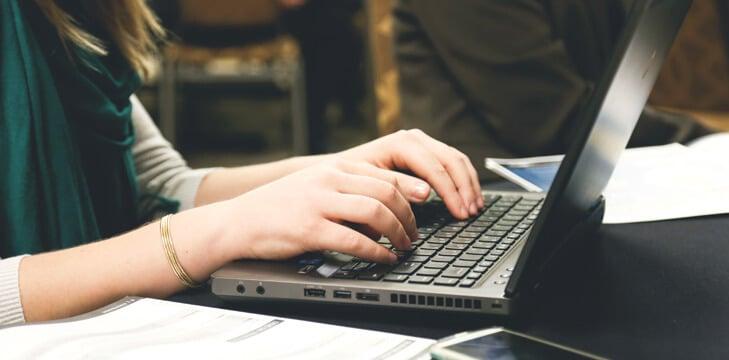 teacher at a computer