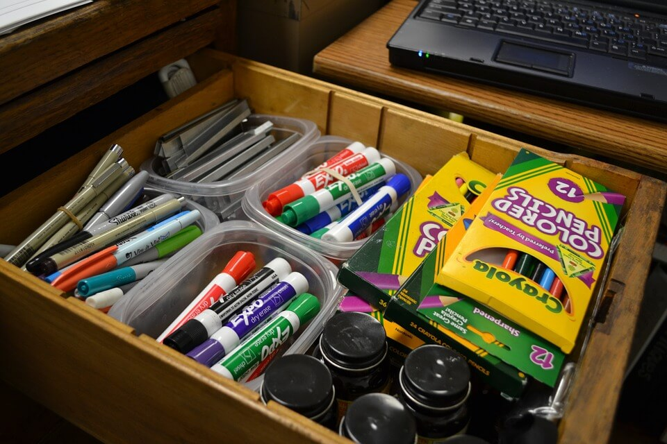 Some of the supplies that teachers need on hand include extra dry erase markers, pens, and colored pencils.
