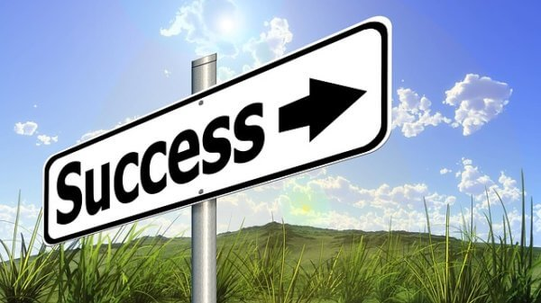 Sign pointing toward success