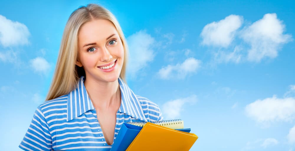 Woman in front of a blue sky for student teaching summer