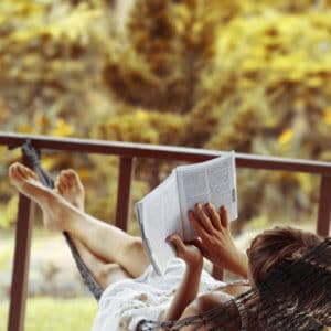 woman in hammock tests how reading can help your praxis score