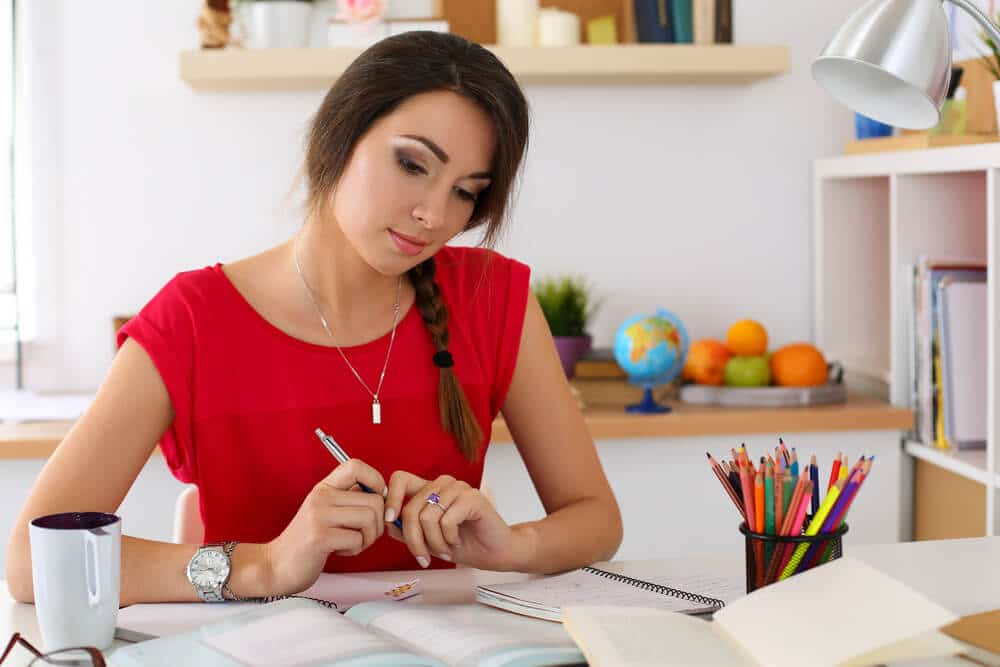 Woman ponders over student teaching lesson plan