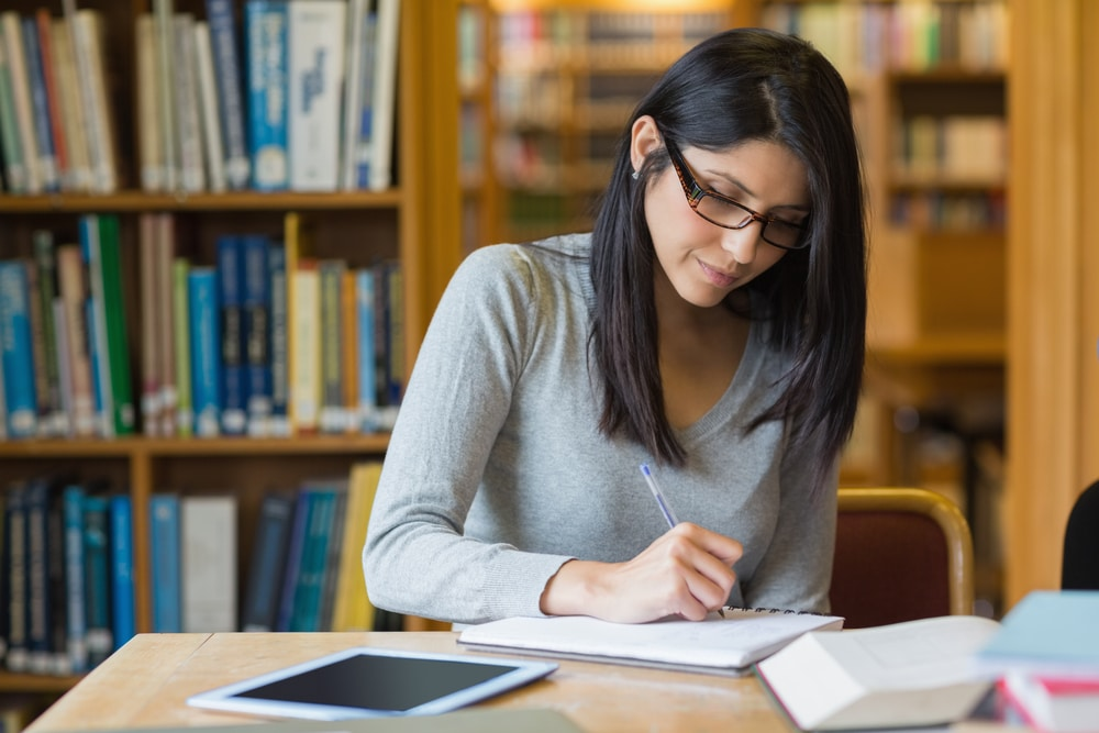 Free MCAT Practice Tests - Woman Studying in Library