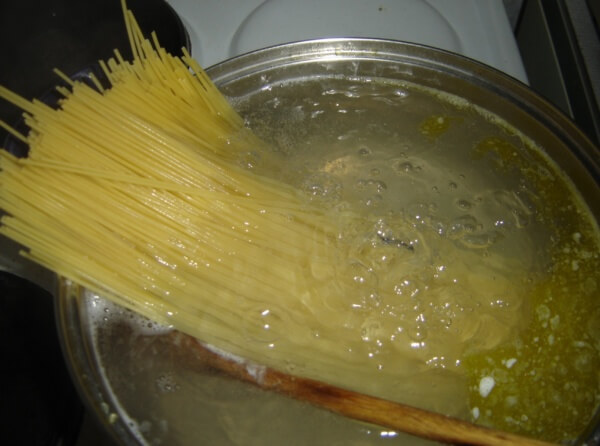 Spaghetti noodles starting to boil