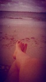 Laying down on the beach