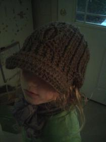 Cable stitched crocheted hat with bill