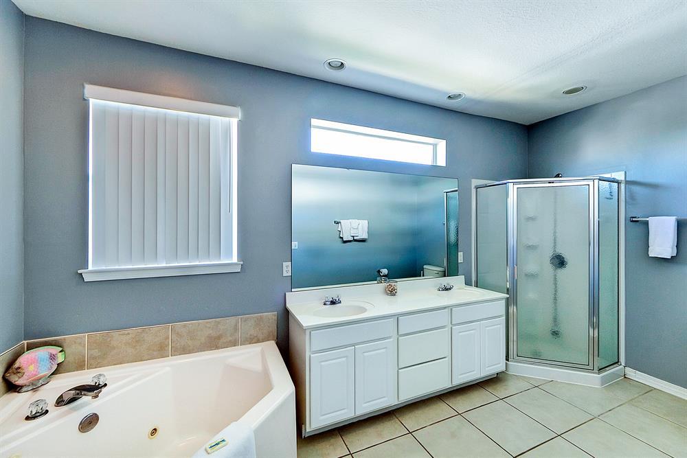 large tub and corner shower