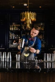 Bartender Pouring Cocktail at the French Room Bar