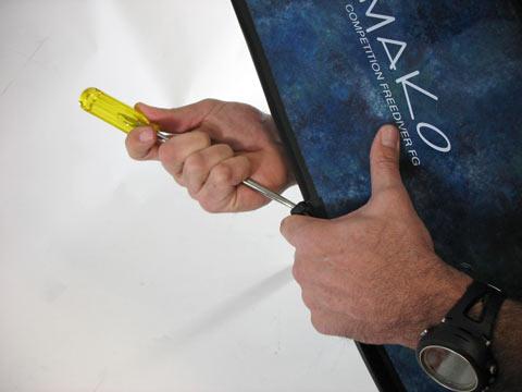 use a screwdriver