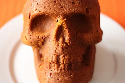 a skull made of cake staring straight at the camera