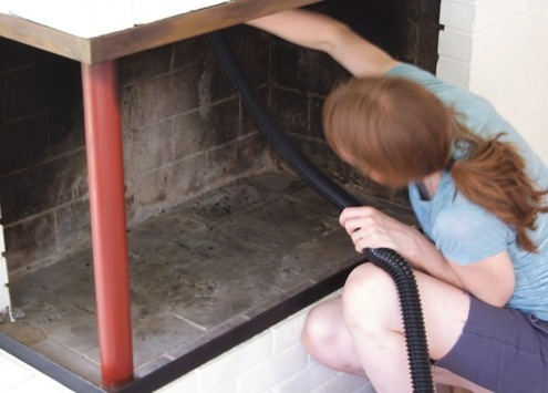 vacuuming the fireplace