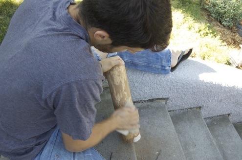 sanding the logs