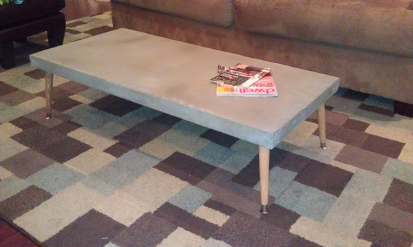 A concrete table by DIY My Homes [http://diymyhomes.wordpress.com/2012/08/22/diy-concrete-table/]