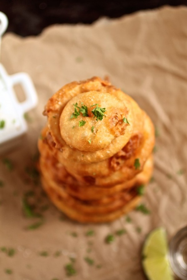 Tequila battered onion rings. Photo by Life as a Strawberry [http://www.lifeasastrawberry.com/tequila-battered-onion-rings-with-honey-lime-yogurt-sauce/]