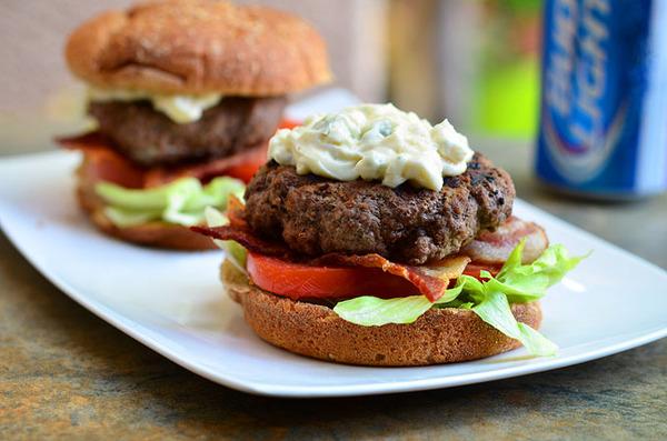 Buffalo bacon, and blue cheese burger via [http://www.onionringsandthings.com/2013/07/buffalo-burgers-with-bacon-and-blue-cheese/]