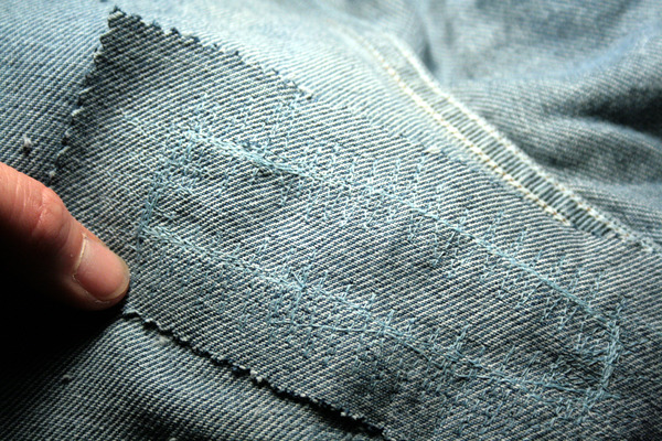 jean patch with extra thread snipped off