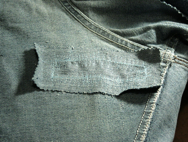 jean patch with excess fabric to cut off